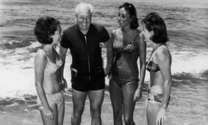 Harold Holt on a beach with three women
