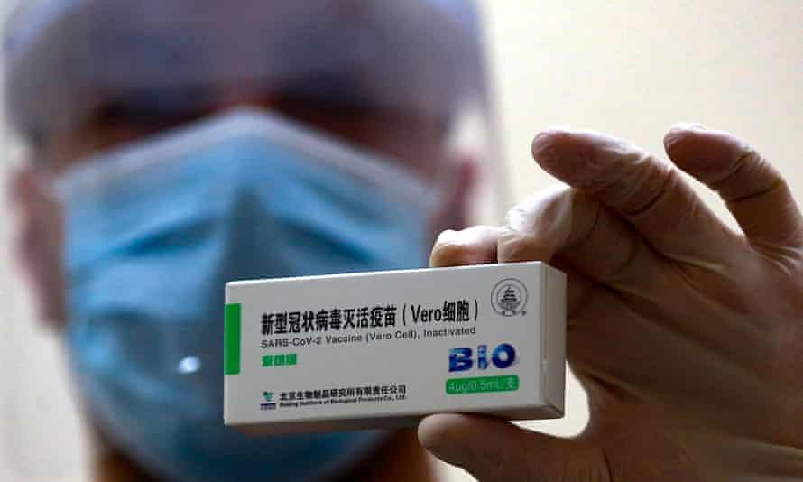 Health worker holding Sinopharm vaccine