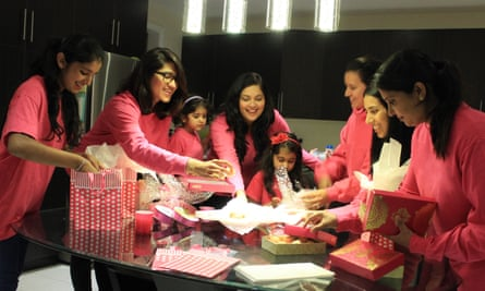 Volunteers in Canada packing boxes of pink ladoos for the campaign
