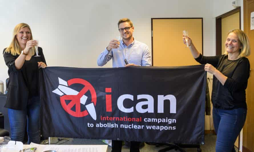Beatrice Fihn (L), Daniel Hogsta (C) and Grethe Ostern, of the International Campaign to Abolish Nuclear Weapons (Ican), celebrate winning this year's Nobel peace prize