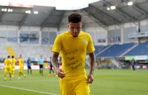 Jadon Sancho celebrates after scoring Borussia Dortmund's second goal.