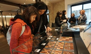 Context Travel. New Parisian Palate: Modern Tastes of the Marais. Two young women look down into a glass cabinet full of artisan chocolates.