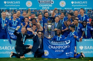 Leicester City's owner Vichai Srivaddhanaprabha (holding the trophy) ands his son, Aiyawatt Srivaddhanaprabha (next to Kasper Schmeichel) join in the celebrations.
