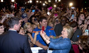 Hillary Clinton greets people in the audience and takes photos during her election night event at the Palm Beach County Convention Center.