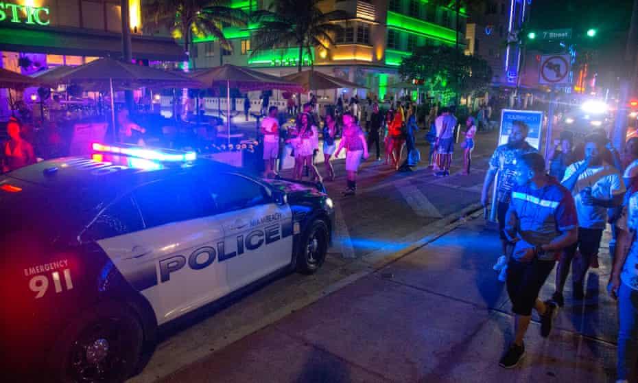 Miami Beach police enforce the 8pm curfew during spring break, in Miami Beach, Florida, this week.