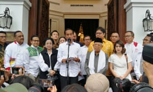 Joko Widodo talks to media during a press briefing in Jakarta