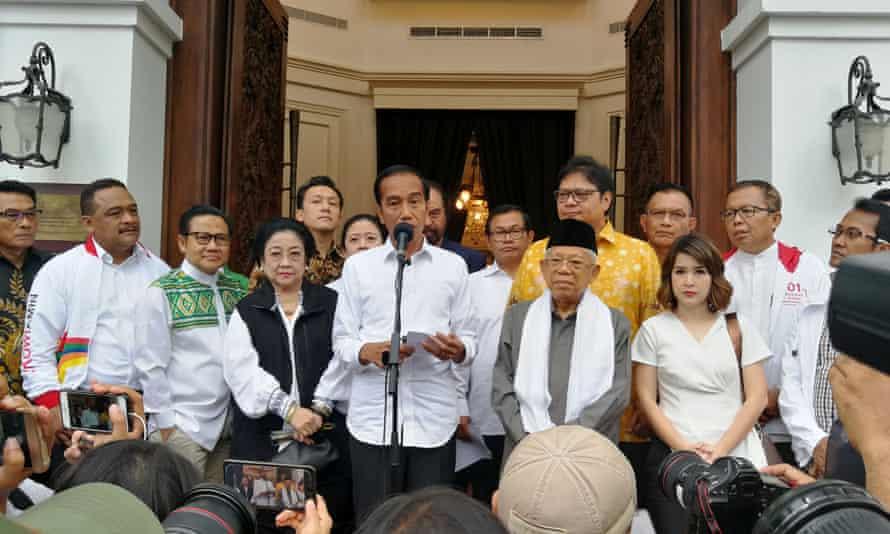 Joko Widodo talks to media during a press briefing in Jakarta