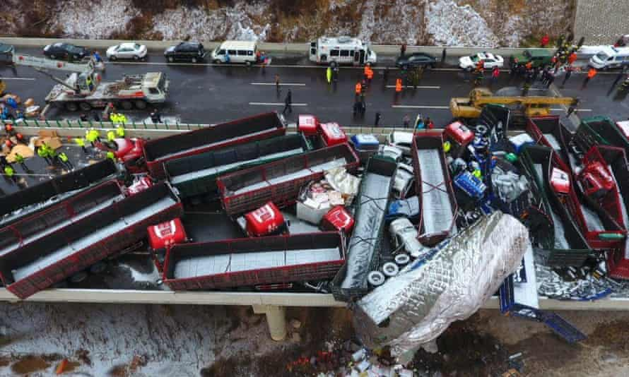 Trucks and cars squashed together after a deadly pile-up involving 56 vehicles on the Kunming expressway in Shanxi province, China.