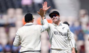 Tom Latham celebrates with Henry Nicholls after taking a catch to dismiss India's Mohammad Shami off the bowling of Tim Southee.