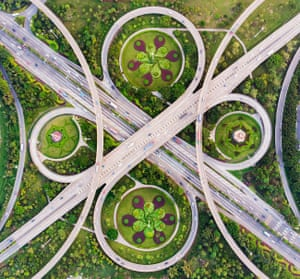 Waltz of Overpass. Only an aerial view is able to show the absolute symmetry of an overpass that fits perfectly among the colour of the surrounding flowerbeds in Foshan City, Guangdong, China