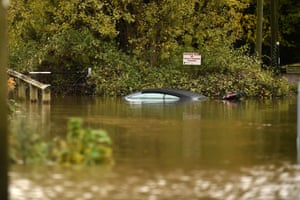 The roof of a car peeks out of the waters of the River Don which burst its banks in Doncaster