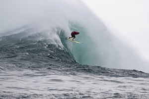 Peahi, Hawaii, US  Keala Kennelly of Hawaii takes the drop on a massive wave at Jaws