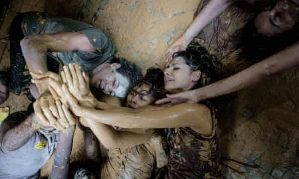 Protesters covered in mud outside Vale headquarters in Rio de Janeiro