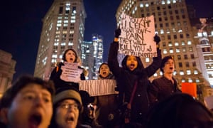 Protesters, demanding justice for Eric Garner, hold placards while shouting slogans in Foley Square, New York.