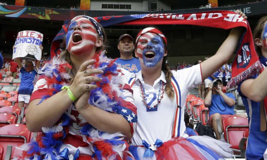 United States fans cheer in the stands before the start of the Women's World Cup final.