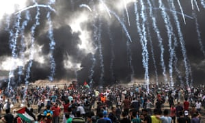 Israeli army fires tear-gas at Palestinian protesters during clashes on Friday 4 May.