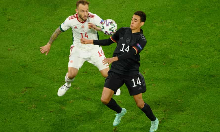 Jamal Musiala, right, who holds British and German passports, fights off a challenge from Gergo Lovrenscics during Germany's Euro 2020 game against Hungary.