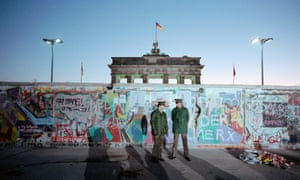 Border guards at the Berlin Wall in 1989.
