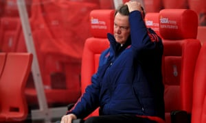 Manchester United's Louis van Gaal sits dejected on the bench at Stoke City