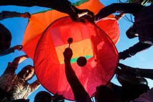 Revellers release a handmade paper lantern in Kolkata, India