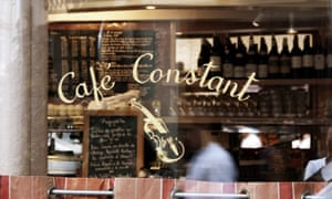 Close up of the window looking in to Le Café Constant, Paris.