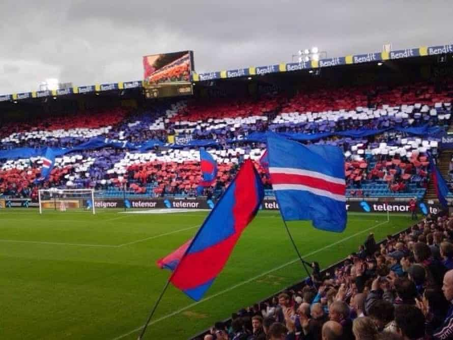 Fans of Norwegian Premier League side Vålerenga display the Norwegian flag prior to a league match.