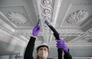 Basingstoke, England A worker cleans the ceiling of the 18th-century Staircase Hall at The Vyne, a 16th-century estate and country house in Hampshire. The process of cleaning the hall takes four staff about two weeks. Described as 'Greek theatrical', the hall features animal skulls and collection plates and was created by the house's former owner John Chute as his ode to classical architecture. The National Trust property is expected to reopen for pre-booked visits from 17 May