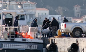 A coastguard vessel brings the bodies of some of the refugees to the port of Vathi