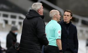 The Fulham manager Scott Parker, right, has words with a match official.