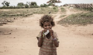 A girl eats a food supplement in Ifotaka, southern Madagascar, in December 2018.