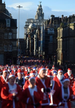 Runners dressed as Father Christmas take part in the annual Santa Dash in Liverpool, England