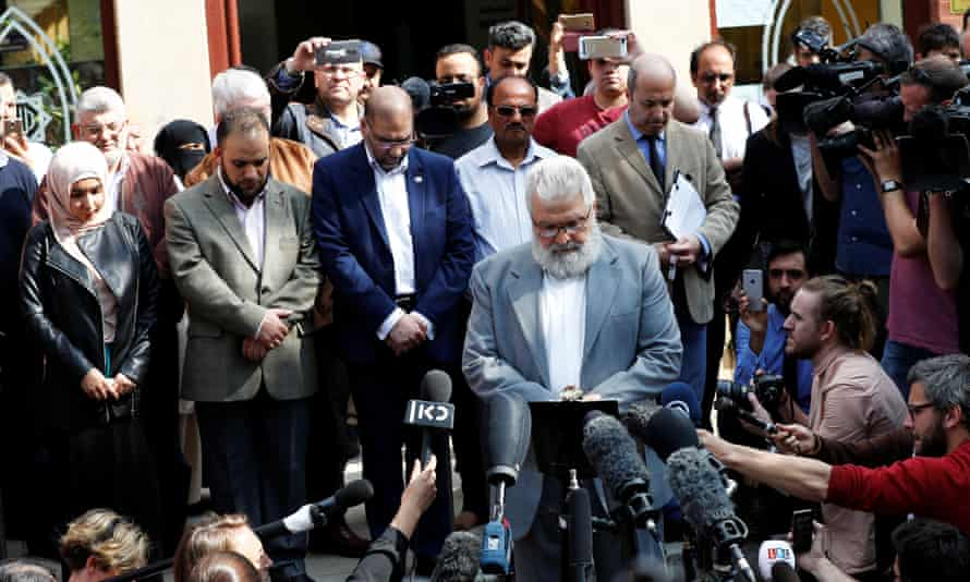 Mohammad el-Khayat, director of trustees at Didsbury mosque, presides over a minute's silence outside the mosque for the victims of the attack on Manchester Arena
