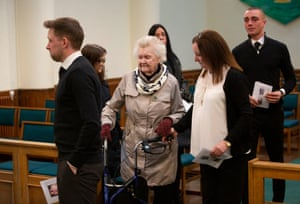 Family members including Annie (centre) comfort each other after the service