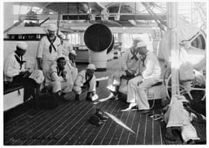 Crewman on deck, with cats, 1898. Note man teasing cat with a mirror and sunlight.