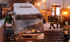 Firemen gather around the crashed bus at the entrance to a pedestrian underpass in Moscow