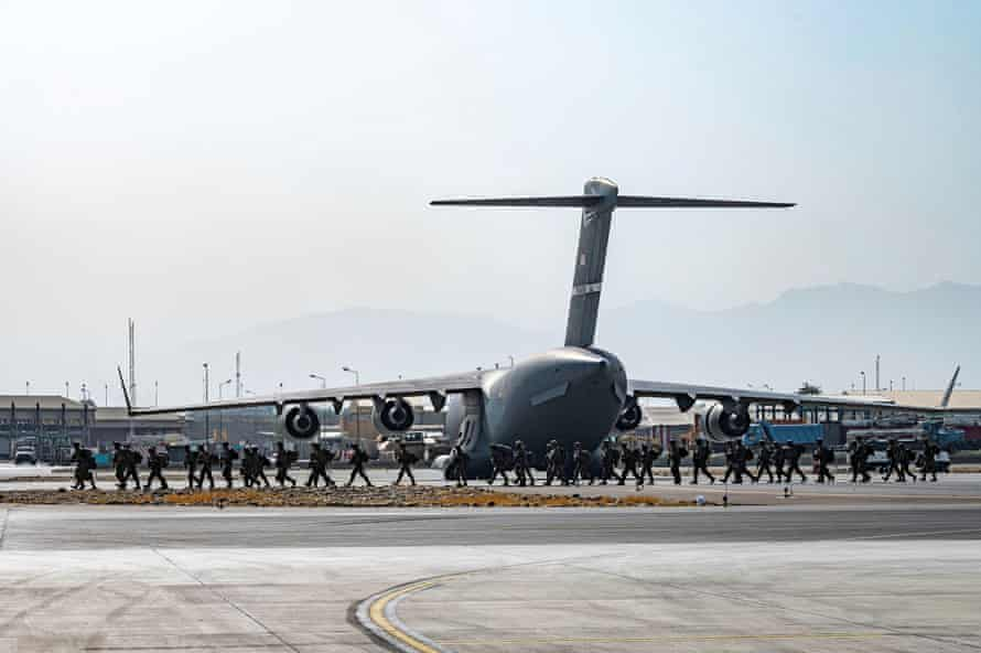 US soldiers arrive to provide security in support of Operation Allies Refuge at the airport in Kabul.