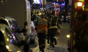 French security rush as people are evacuated in the area of Rue Bichat in the 10th arrondissement.