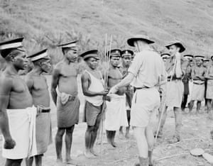 A patrol officer paying members of the Royal Papua New Guinea constabulary for their services in 1948.