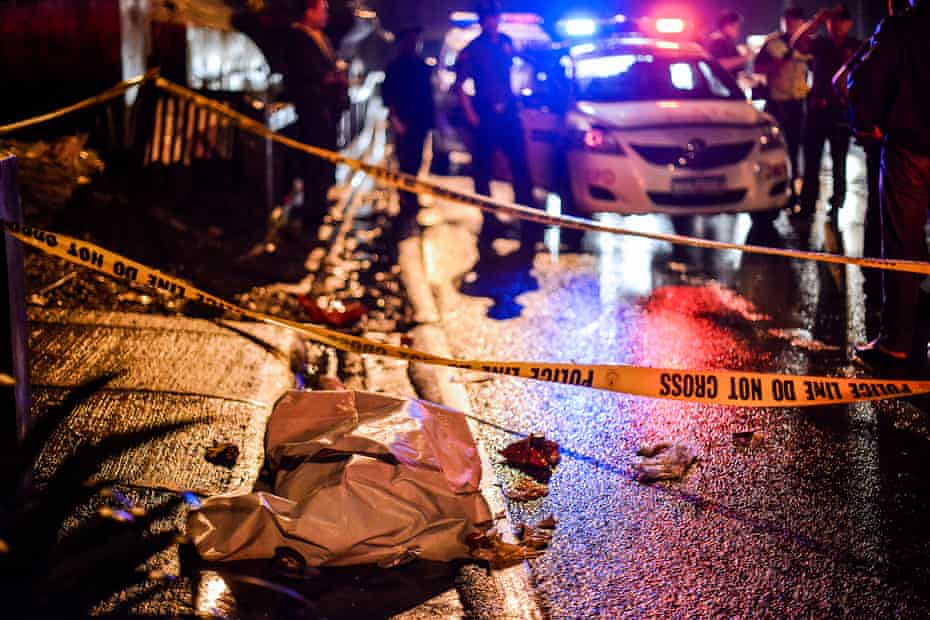 The body of a suspected drug dealer lies in a Manila street, the victim of a vigilante-style execution.