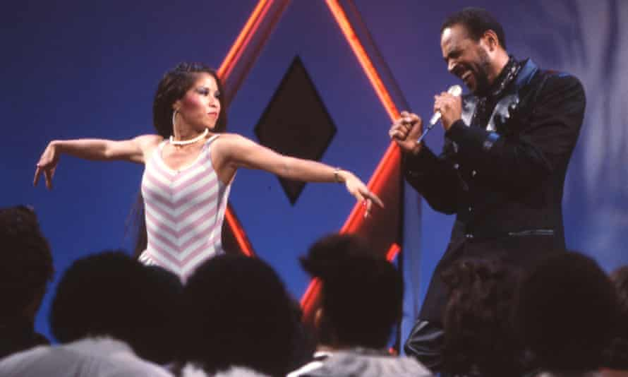 Let's waack … Cheryl Song joins Marvin Gaye onstage for a performance on Soul Train.