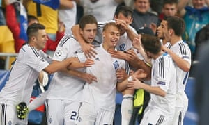 Vitaliy Buyalskiy, centre, is mobbed by his team-mates after his late goal ensured Porto did not ruin Dynamo Kyiv's return to the Champions League.