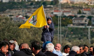 Palestinians protest against a road closure by Israeli settlers opposite the Kfar Adumim settlement in the occupied West Bank.