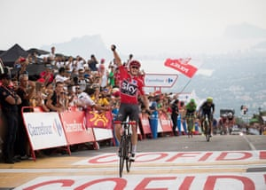 Chris Froome celebrates as he crosses the finish line to win Stage 9