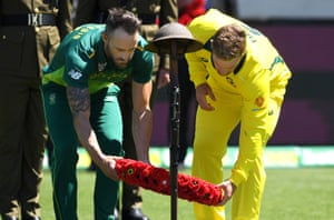 Cricket captains Aaron Finch of Australia and Faf du Plessis of South Africa lay a wreath during a memorial service at Bellerive Oval