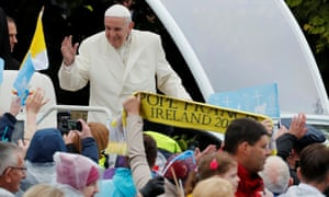 Pope Francis greets onlookers from his 'Popemobile'