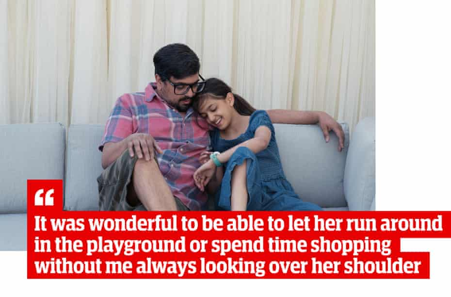 """Picture of Mango and Amber sitting on sofa looking at the Neo with quote: """"It was wonderful to be able to let her run around in the playground or spend time shopping without me always looking over her shoulder"""""""