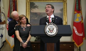 Joe Biden puts his hands on Stephanie Carter's shoulders as her husband, Ashton Carter, is being sworn in as secretary of defense on 17 February 2015.
