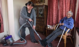 Jenny Dutton doing the vacuuming for Pam King at her cottage in Somerset