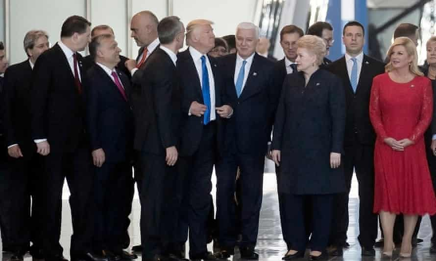 Donald Trump after pushing the Montenegrin prime minister, Dusko Markovic, aside as they walked through the Nato headquarters in Brussels in May.