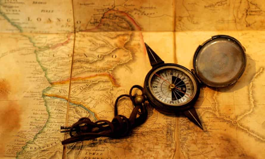 A compass lies on a map of Africa, with the course of the Congo pencilied in by African explorer Henry Stanley, at the Christie's auction house in London August 1, 2002.